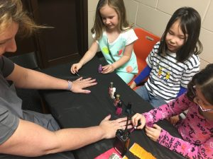 Mrs. Kunz gets her nails painted by first graders at the market.